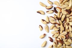 Many brasil nuts and space for text on white background. Top view stock images