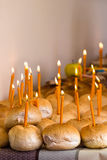 Many breads with lighted candles Stock Image