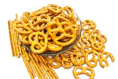 Many breadsticks and pretzels. Many salted pretzels and breadsticks on white Royalty Free Stock Photography