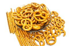 Many breadsticks and salted pretzels. Breadsticks and pretzels closeup on white background Stock Photos