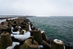 Many breakwaters with snow on the northern mall in the town of Baltiysk, Kaliningrad, Russia Stock Photos