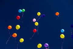 Many bright baloons in the blue sky Royalty Free Stock Photos
