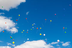 Many bright baloons. In the blue sky stock photo