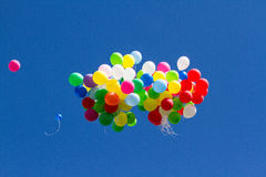 Many bright baloons in the blue sky Royalty Free Stock Photo
