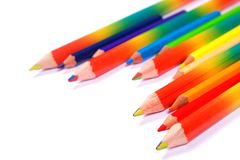 Many bright colorful pencils on white background stock photos