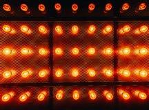 Many bright glowing glass lamps. Illumination of set Edison retro lamps on dark rabitz background. Fashionable loft. Design with Fashionable loft design with stock photo