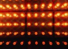 Many bright glowing glass lamps. Illumination of set Edison retro lamps on dark rabitz background. Fashionable loft. Design with Fashionable loft design with royalty free stock images