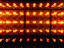 Many bright glowing glass lamps. Illumination of set Edison retro lamps on dark rabitz background. Fashionable loft. Design with Fashionable loft design with royalty free stock photo