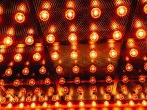 Many bright glowing glass lamps. Illumination of set Edison retro lamps on dark rabitz background. Fashionable loft. Design with Fashionable loft design with stock photography