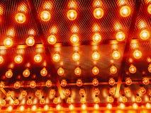 Many bright glowing glass lamps. Illumination of set Edison retro lamps on dark rabitz background. Fashionable loft. Design with Fashionable loft design with royalty free stock image