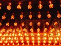 Many bright glowing glass lamps. Illumination of set Edison retro lamps on dark rabitz background. Fashionable loft. Design with Fashionable loft design with royalty free stock photos