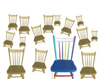 Many brown chairs and one colorful Stock Photo