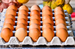 Many brown eggs in boxes. Stock Photo