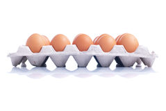 Many brown eggs laid in a tray  on white background with Royalty Free Stock Image