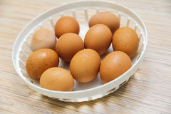 Many brown eggs in a plate Stock Photos