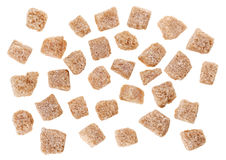 Many brown lump cane sugar cubes isolated Stock Photography