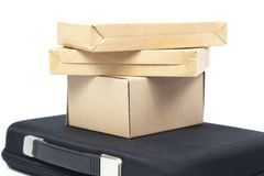 Many brown paper box on a black briefcase. Royalty Free Stock Photography