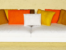 Many brown pillows on the sofa Royalty Free Stock Image