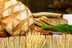 Many brown rustic fresh rye bread loaves Stock Photo