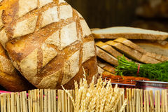 Many brown rustic fresh rye bread loaves Stock Image