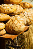 Many brown rustic fresh rye bread loaves Royalty Free Stock Photos