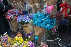 Many brunch of flower bouquet hanging on stall in commencement d. Ay for a gift to cerebrate graduater in university Royalty Free Stock Photos