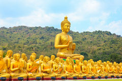 Many buddha statue under blue sky in temple. Nakornnayok , Thailand Stock Photo