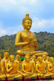 Many buddha statue under blue sky in temple. Nakornnayok , Thailand Royalty Free Stock Photography