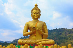 Many buddha statue under blue sky in temple. Nakornnayok , Thailand Stock Photos