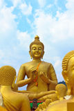 Many buddha statue under blue sky in temple. Nakornnayok , Thailand Royalty Free Stock Photo