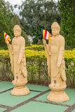 Many Buddha statues in perspective at the buddhist temple Stock Images