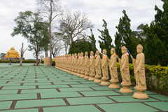 Many Buddha statues in perspective at the buddhist temple Royalty Free Stock Photo