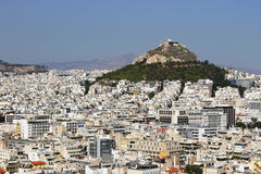 Many buildings and big hilltop in Athens Greece. Many white buildings and very big hilltop in the middle of Athens Greece. The hill is named Mount Lycabettus royalty free stock photography