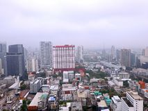 Many buildings in the mist and dark sky in Bangkok, royalty free stock photo
