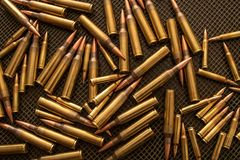 Free Many Bullets Calibre .338 And .223 On A Table With A Green Net Stock Photo - 164958200