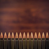 Many bullets closeup on a wooden background Royalty Free Stock Images