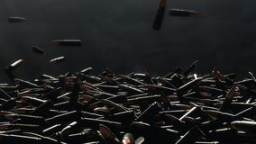 Many bullets fall on the table. In the background a dark wall royalty free stock photos