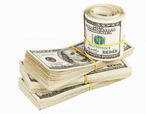 Many  bundle and roll of US 100 dollars bank notes Stock Photos