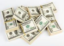 Many  bundle of US 100 dollars bank notes. Over white Stock Photo