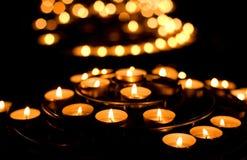 Many burning candles Stock Photography