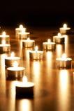 Many burning candles Stock Photos