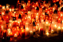 Many burning candles in graveyard. At night Royalty Free Stock Images