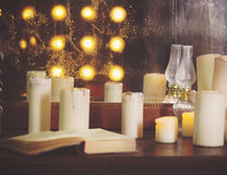 Many burning candles on a mirrored background Stock Image
