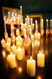 Many burning candles on a mirrored background. Romantic atmosphere Royalty Free Stock Photos