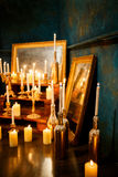 Many burning candles on a mirrored background. Romantic atmosphere Stock Photo