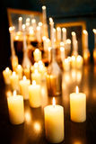 Many burning candles on a mirrored background. Romantic atmosphere Royalty Free Stock Photo