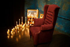 Many burning candles on a mirrored background. Romantic atmosphere Royalty Free Stock Images