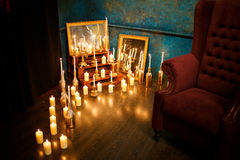 Many burning candles on a mirrored background. Romantic atmosphere Stock Images