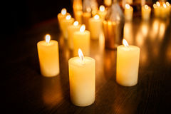 Many burning candles on a mirrored background Stock Photography