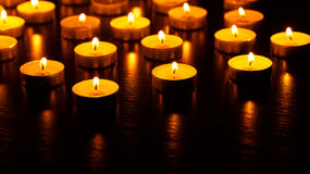 Many burning candles with shallow depth of field Stock Image